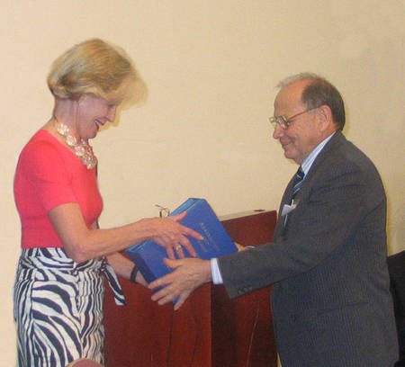 Angelo Notaras presents the Governor of Queensland Ms Quentin Bryce, AC, with all three volumes of the great Hugh Gilchrist's book, Australians & Greeks..
