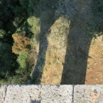 In the shadow of a bridge