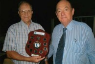 John Prineas and Paul Summers holding the interstate shield