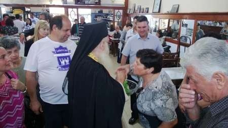 Receiving individual blessings, during the blessing of the Canberra cafe celebrations