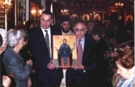 The icon of Ayios Haralmbos being carried around the Church. 2005.