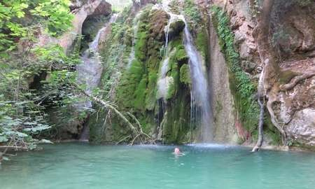 Kalami beach - Guardian Jemima swimming at the second waterfall down from Mylopotamos