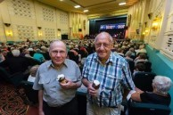"""Spiro and Angelo Notaras eating ice cream at """" The Proms"""" concert the Saraton Theatre ."""