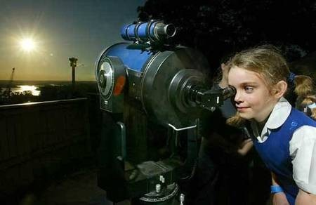 Venus - the PLANET - seven-year-old Jodie McGowan, of Artarmon, (Australia, has her turn at the telescope at Sydney's Observatory Hill. - Venus Transit - Seven-year-old Jodie McGowan of Artarmon has her turn at the telescope at Sydney's Observatory Hill. Photo  Robert Pearce
