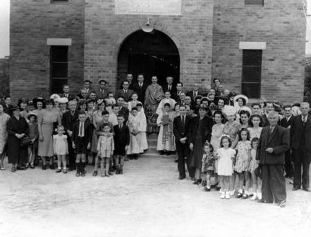 Congregation and priest outside St. Theodores Greek Orthodox Church in Townsville, 1947. - Congregation of St. Theodores Greek Orthodox Church in Townsville, 1947