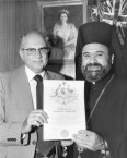 The Greek Orthodox Primate receiving his naturalisation certificate in 1979.