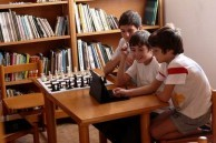 Children enjoy playing with an Ipad in the Library.
