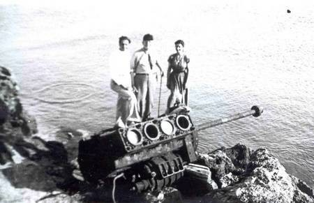 large broken engine and Uncle Ted with others