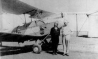 'Lores' Bonney and her aeroplane at Charleville airport, Queensland, 1933.