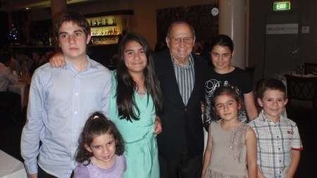Angelo Notaras surrounded by his grandchildren