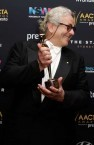 Held the dream for 36 years ... Director George Miller poses with the AACTA Award for Best Film for Mad Max: Fury Road.