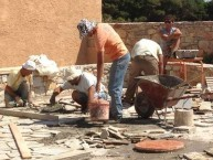 """Laying the """"coritzo'' tiles in the courtyard of the Kytherian Municipal Library 2"""
