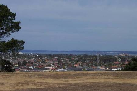 Looking South from the main entrance, across the city of Geelong, to the sea.