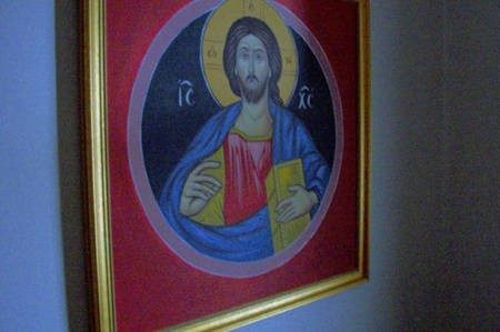 Icon of Christ. Wall on stairway,