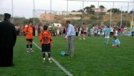 Peter Magiros testing his soccer skills on the stadium he built in Livathi, Kythera
