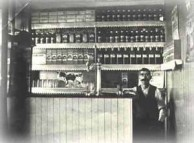 Woodburn, NSW - Kytherian store owner at counter of his store, circa 1922/23.