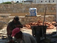 """Laying the """"coritzo'' tiles in the courtyard of the Kytherian Municipal Library 3"""