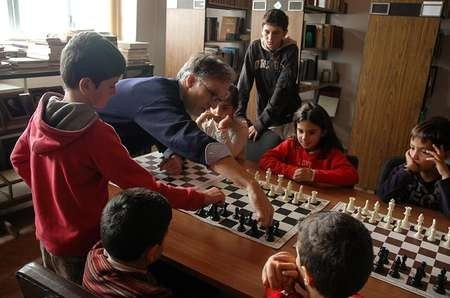 Young Kytherians learning chess at the Library.