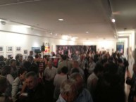 Part of the large crowd that attended the opening of the Cafe exhibition