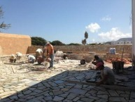 """Laying the """"coritzo'' tiles in the courtyard of the Kytherian Municipal Library"""